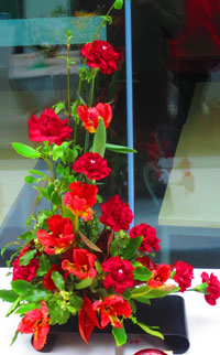 formal flower arrangement of red tones