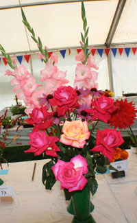 Colourful arrangement of roses and gladioli at the Summer Flower Show